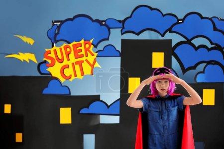 Cute girl as superhero against decoration. Comic strip city theme