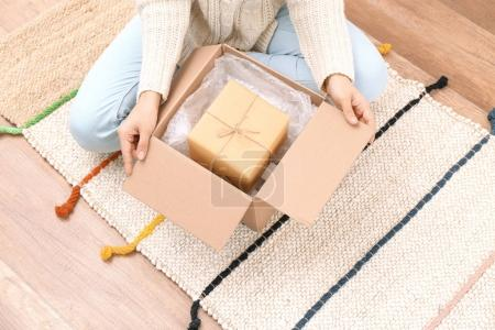 Woman with parcel box