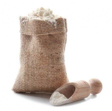 Sack and scoop with wheat flour