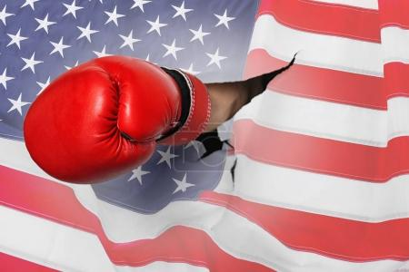 Hand with boxing glove breaking
