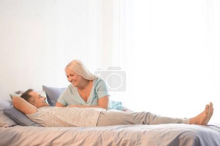 Senior couple on bed