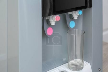Office water cooler with glass, closeup