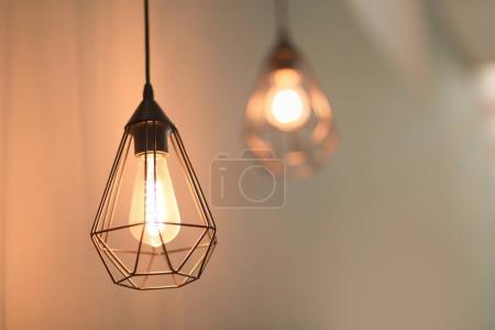Elegant lamp on blurred background