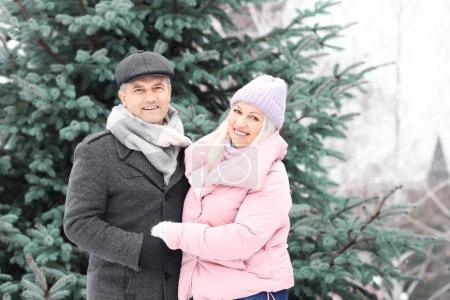 Photo for Portrait of happy mature couple in winter park - Royalty Free Image