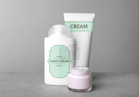 Photo for Body cream set on table against grey background - Royalty Free Image
