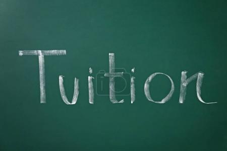 Photo for Word TUITION written on chalkboard - Royalty Free Image