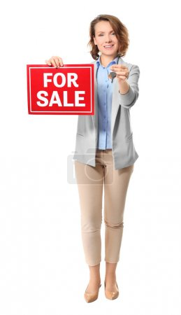 "Beautiful real estate agent with ""For sale"" sign and key on white background"