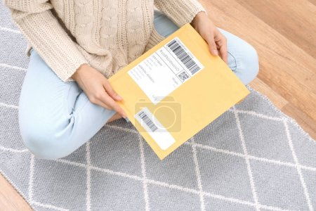 Woman with parcel package indoors