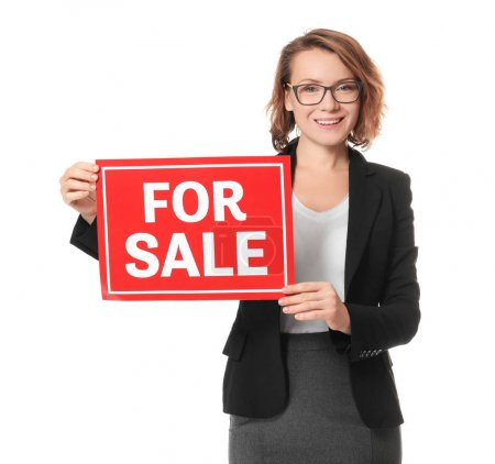 "Beautiful real estate agent with ""For sale"" sign on white background"