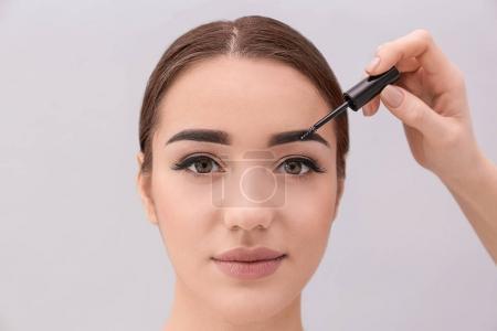 woman undergoing eyebrow correction procedure