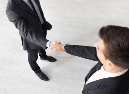 Two man shaking hands as symbol of unity