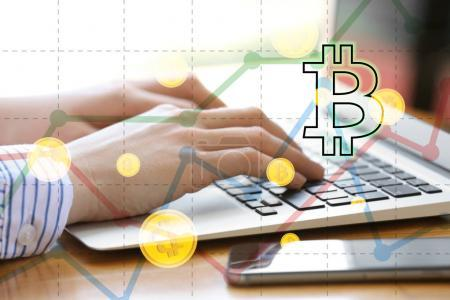 Bitcoin rate and woman using laptop at table on background