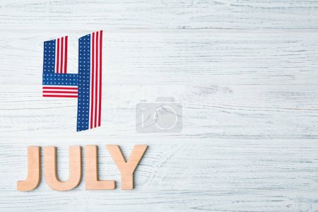 """Composition with phrase """"4 July"""" on light background. Patriotic American holiday"""