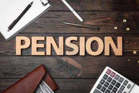 Word pension, calculator, money and pens on wooden background