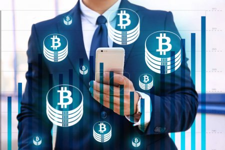 Bitcoin rate and businessman using smartphone on background