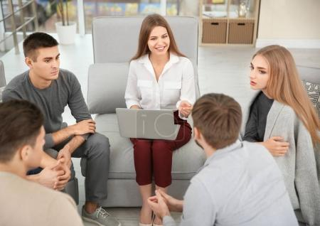 Therapist working with her group during session