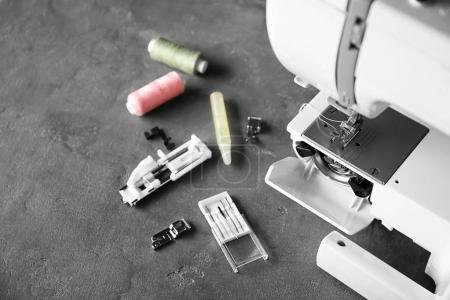 Threads and sewing machine on table