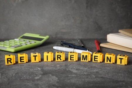 Word retirement on dark table, pension planning