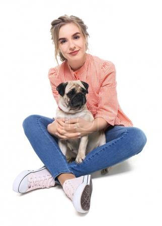 Young woman with cute pug dog on white background. Pet adoption