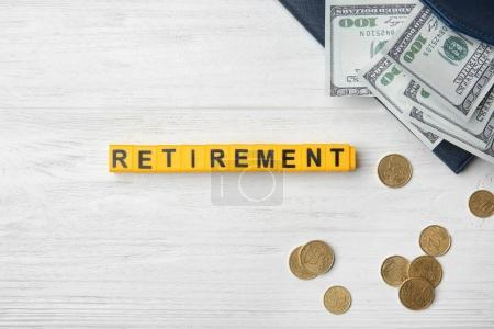 Word retirement and money on light background, pension planning