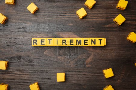 Word retirement on wooden background, pension planning