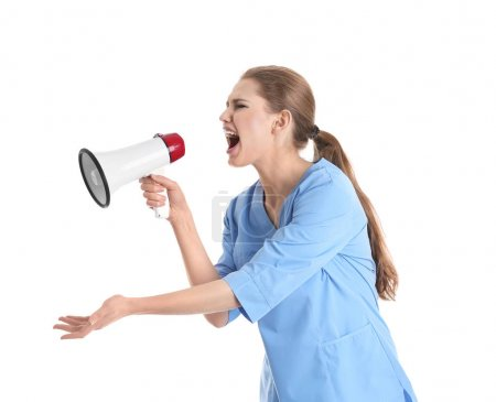 Young female doctor shouting into megaphone on white background