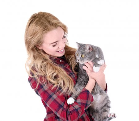 Portrait of young woman with cat on white background. Pet owner