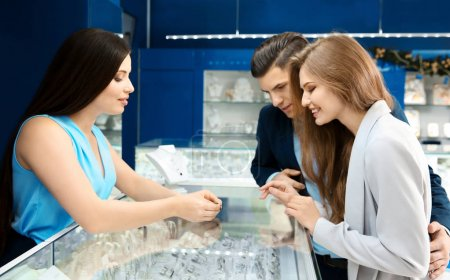 Young couple choosing ring in jewelry store
