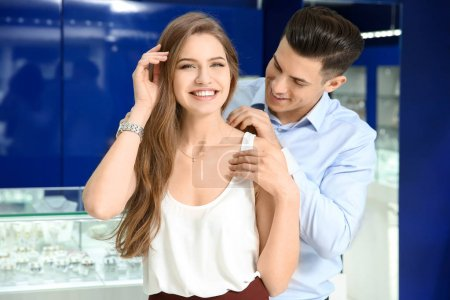 Young couple choosing necklace in jewelry store