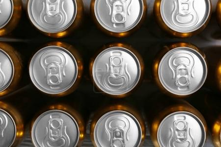 Cans of fresh beer, top view