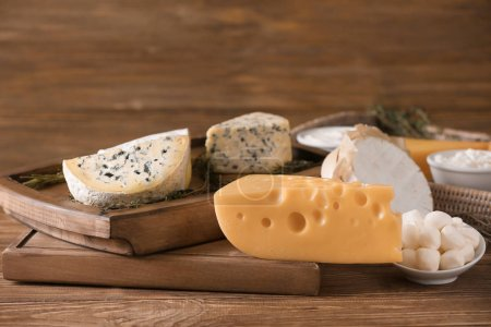 Different cheeses on table. Fresh dairy products
