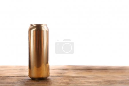 Can of beer on wooden table against white background
