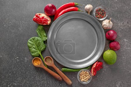 Metal plate and products on grey background