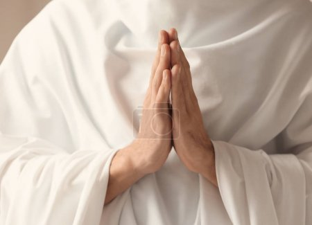 Young monk praying