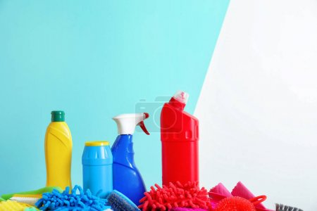 Photo for Cleaning supplies and tools on color background - Royalty Free Image