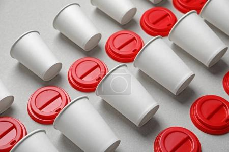 Composition with blank cups as mock ups for branding on light background