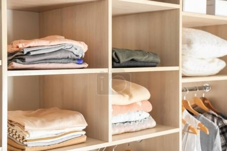 Photo for Organized wardrobe closet with clothes - Royalty Free Image