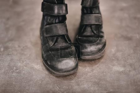 Old shoes on grey background. Poverty concept