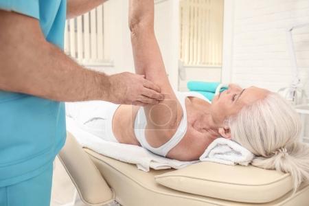 Elderly woman getting massage