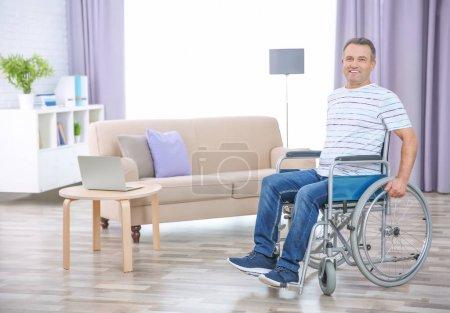 Mature man in wheelchair