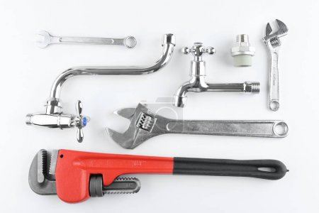 Plumbers items on white