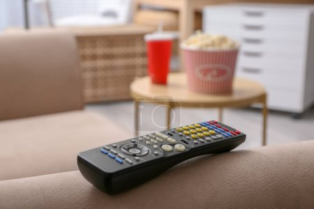 TV remote control on couch indoors, closeup. Home cinema
