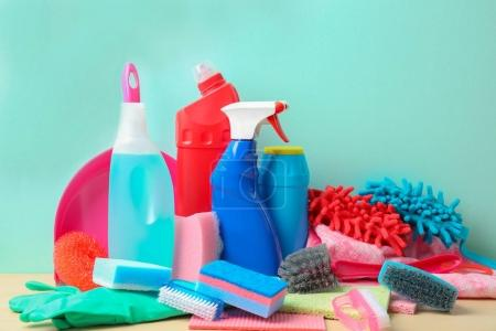 Photo for Set of cleaning supplies on table against color background - Royalty Free Image