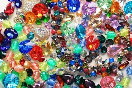 Jewellery with various colorful precious stones, closeup