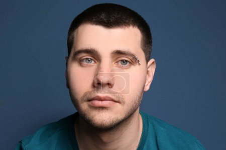 young man with pierced eyebrow