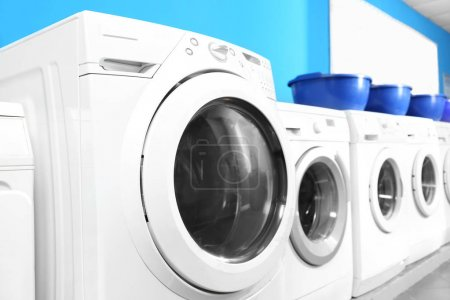 Industrial laundry machines in laundromat