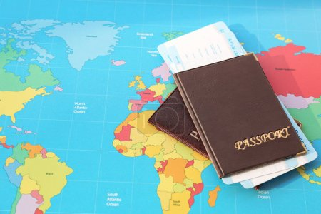 Passports with arrival cards of immigration bureau on world map