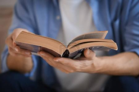 Religious young man reading Bible