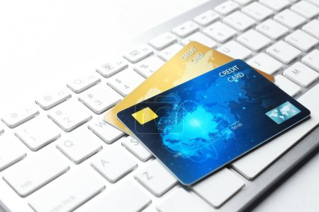 Photo for Close up of credit cards on white keyboard - Royalty Free Image