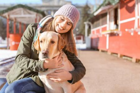 Photo for Woman with her cute lovely dog outdoors. Friendship between pet and owner - Royalty Free Image